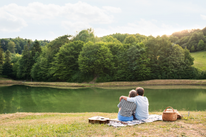 Couple having a picnic cuddling