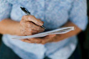 Elderly woman writing her will