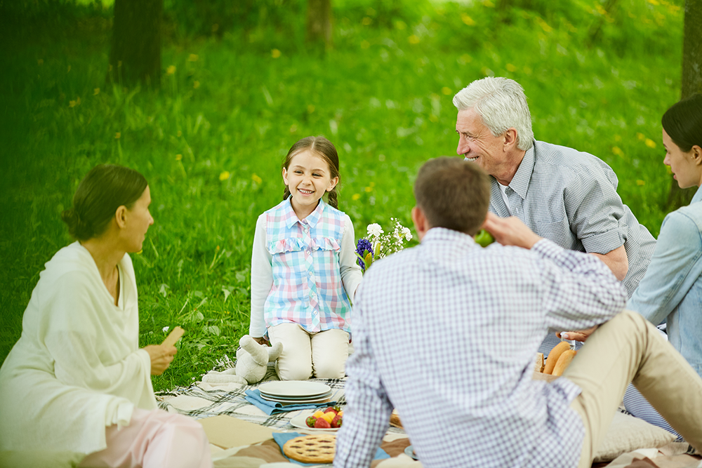 Family having picnic laughing