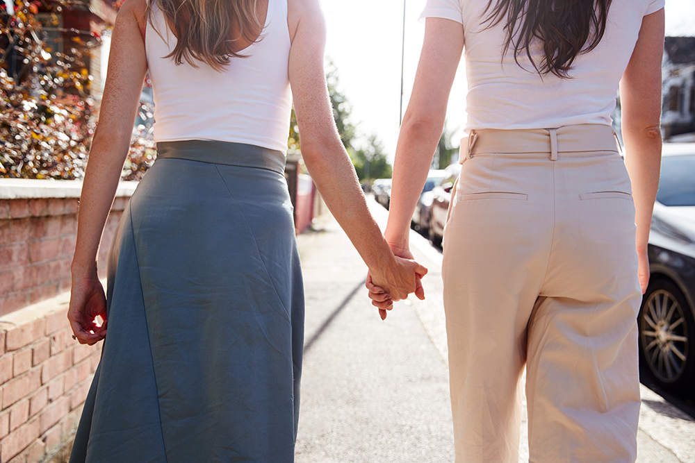 Two women holding hands in relationship